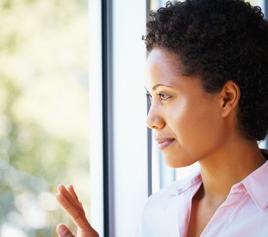 black-woman-looking-out-window-pf-378x334