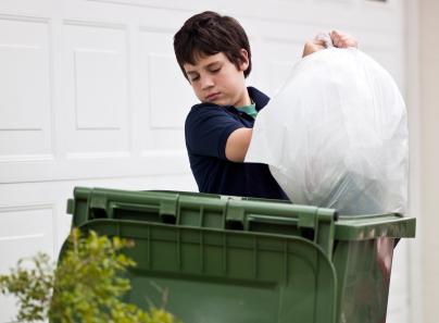 boy-taking-out-trash